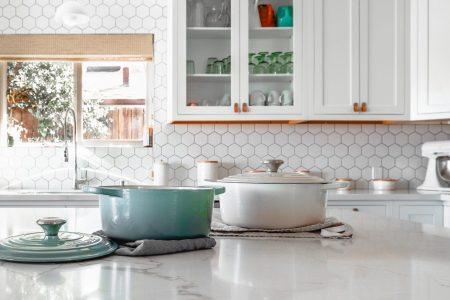 white kitchen like Ramona Aline Home organizer and stylist. aqua and white pots on white quartz island